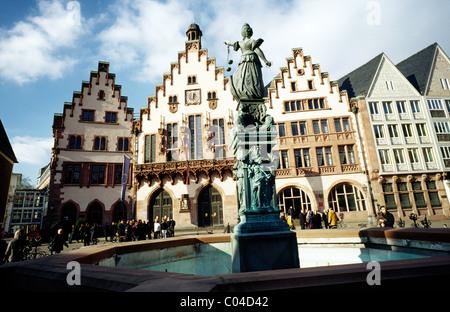 Medieval Germany - Well of Justice (Gerechtigkeitsbrunnen) in front of Römer city hall at Römerberg in Frankfurt - Stock Photo