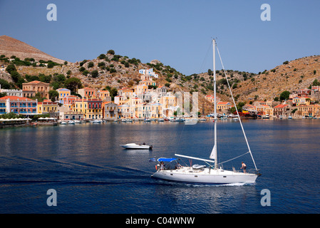 Greece, Symi island, Dodecanese. Partial view of Gyalos, capital and main port of the island. - Stock Photo
