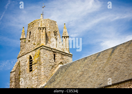 Norman church with unusual rounded square tower in Regneville-Sur-Mer in Normandy, France - Stock Photo
