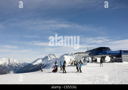 St Anton am Arlberg, Tyrol, Austria. Skiers on snow slopes at the top of chairlift in the Galzig ski area in the - Stock Photo
