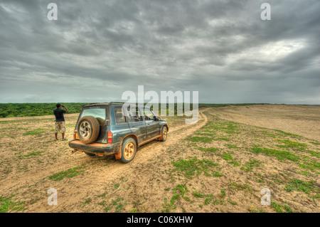 A safari jeep with tourists, Bundala National Park Sri Lanka - Stock Photo