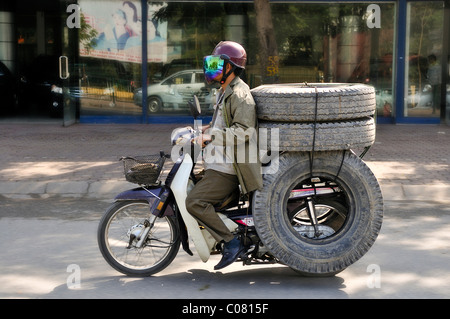 Scooter loaded with tires, Hanoi, Vietnam, Southeast Asia - Stock Photo