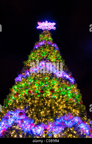 Christmas tree and lighting and decorations at The Village At Gulfstream Park in Hallandale, Florida, USA - Stock Photo