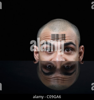 Portrait of a businessman with barcode on his forehead - Stock Photo