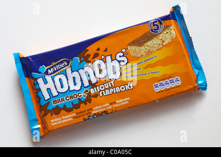 Packet of Mcvitie's Hobnobs milk choc biscuit flapjacks, milk chocolate biscuits isolated on white background - Stock Photo