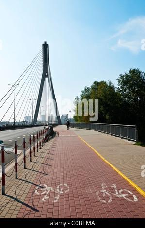 Modern, contemporary suspension Ṡwiętokrzyski bridge with cycle route marks on road surface, Warsaw, Praga, Poland, - Stock Photo
