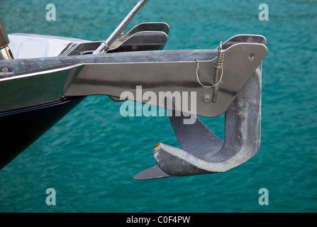 Close up of a stainless steel anchor on a large ocean going yacht - Stock Photo