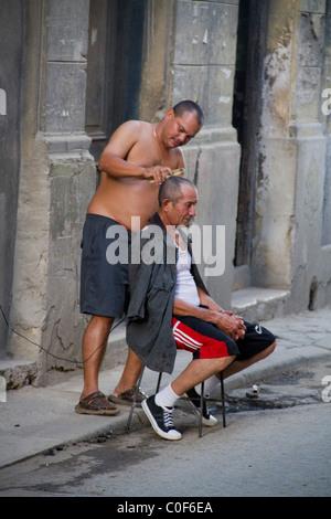Street scene in Havann Viejo,open air hair cutter, Havanna Cuba - Stock Photo