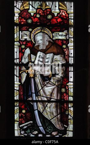 A stained glass window by C E Kempe & Co. depicting Saint Paul, St John Baptist Church, North Luffenham, Rutland - Stock Photo