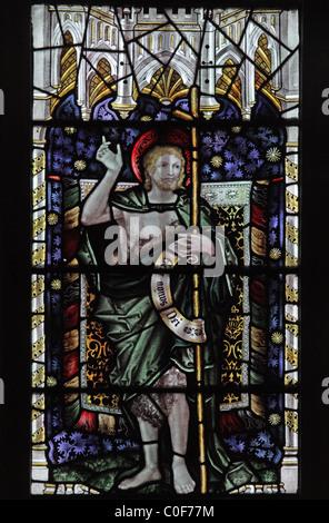 A stained glass window by C E Kempe & Co. depicting St John the Baptist, St John Baptist Church, North Luffenham, - Stock Photo