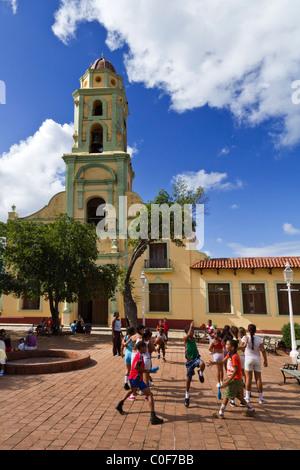 Bell tower of Iglesia y Convento de San Francisco,School class sports, Trinidad Cuba - Stock Photo