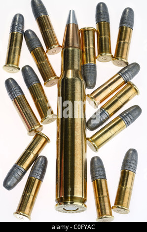 Winchester 30 06 Springfield cartridge and 22 calibre lead rifle bullets on white background - Stock Photo