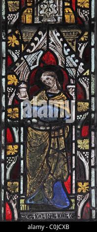 A 14th century stained glass window depicting St Mary Magdelene, St John Baptist Church, North Luffenham, Rutland - Stock Photo
