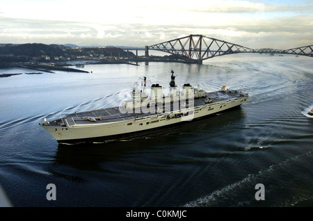 Aircraft carrier the HMS Ark Royal coming under the forth rail bridge on its way to Rosyth dock yard. - Stock Photo