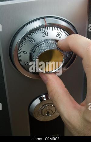 Hand Turning Combination Lock on Safe - Stock Photo