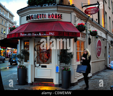Spaghetti House on a street corner in London with woman walking past - Stock Photo