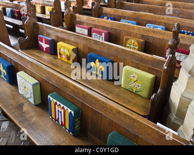 Hassocks on church pews. - Stock Photo