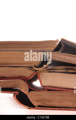 Pile of old books isolated against a white background with copy space - Stock Photo