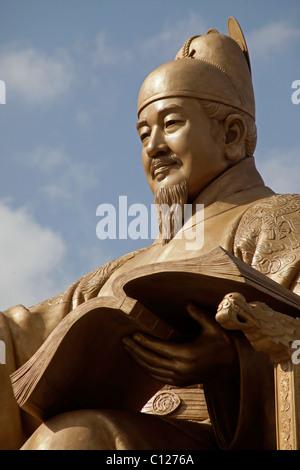 Golden statue of King Sae Jong Dae at Gwanghwamun Plaza in downtown Seoul, South Korea, Asia - Stock Photo