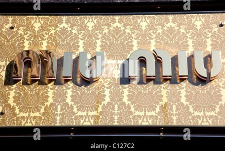 Sign on Miu Miu shop, London - Stock Photo