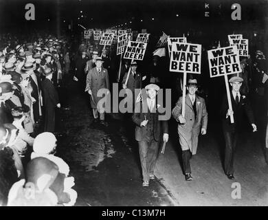 Labor union members protesting Prohibition in Newark New Jersey carrying signs reading 'We want beer.' October 1931. - Stock Photo