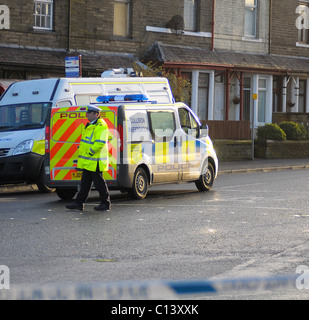 Police clearing up after young boy knocked down by hit and run driver - Stock Photo