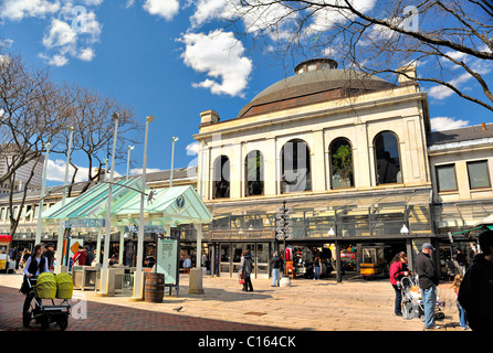 Shoppers, Bostonians and tourists enjoy Faneuil Hall Marketplace in Boston, Massachusetts USA on a spring day near - Stock Photo