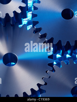 Cog wheels on blue surface - Stock Photo