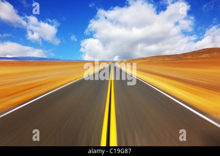 Mirage on high speed in desert - Stock Photo