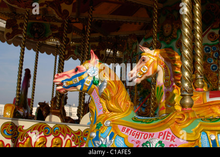 Brightly coloured fairground horse on traditional roundabout. Brighton Pier. East Sussex. England - Stock Photo