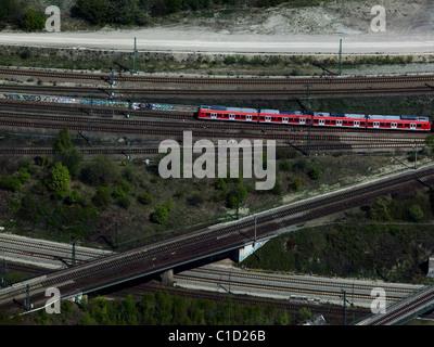 aerial view above Deutsche Bahn passenger train rail road tracks near central station Munich Germany - Stock Photo