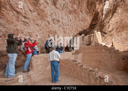 Visitors at Upper Cliff Dwelling at Tonto National Sonoran Desert, Arizona, USA - Stock Photo
