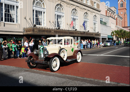 Ford Model A, a 1930's vintage restored car, parading in 2011 St. Patrick's Day parade. - Stock Photo