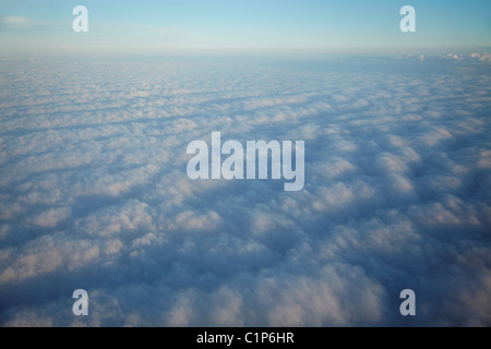 View from plane of clouds - Stock Photo