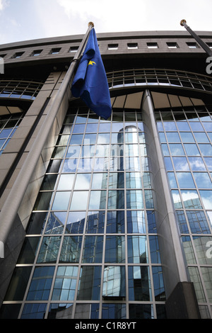 European flag in front of the EU Parliament - Brussels, Belgium - Stock Photo