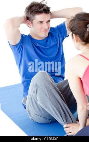 Young man doing fitness exercises with a woman - Stock Photo