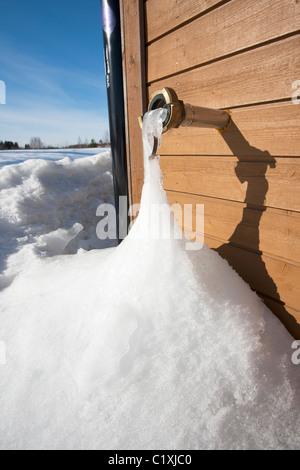 frozen water leakage in winter Finland Europe - Stock Photo