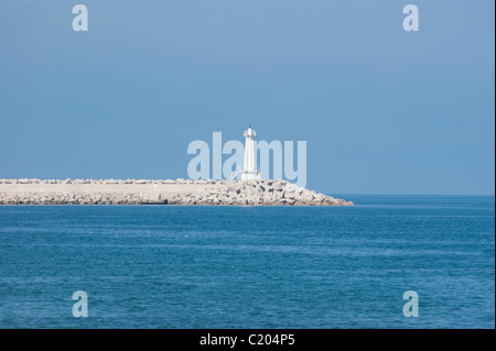 View on sea and lighthouse from coast city Bar in Montenegro - Stock Photo
