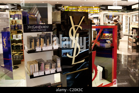Yves Saint Laurent shop in the Duty Free shopping area, terminal 5, Heathrow airport London UK - Stock Photo
