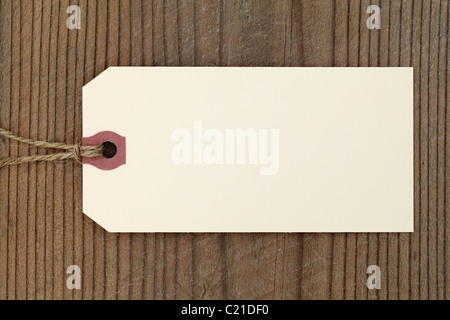 Blank label on wooden texture - Stock Photo