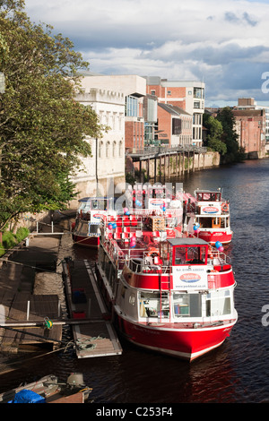 Pleasure boats moored for the evening along the River Ouse in York City, East Yorkshire - Stock Photo