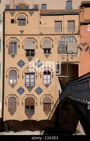 Gomez Bridge and Colorful Facade in Girona, Catalonia, Spain - Stock Photo