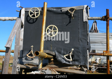 Five valve flywheels outside the wooden construction on the drillsite. Yamal, RUSSIA - Stock Photo