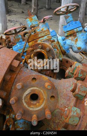Rusty overage wellhead equipment and cut X-mas lie on a scrap yard. Yamal peninsula, RUSSIA - Stock Photo