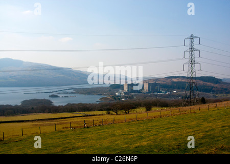 Decommissioned Trawsfynydd nuclear power station site with pylon and lake Gwynedd North Wales UK - Stock Photo
