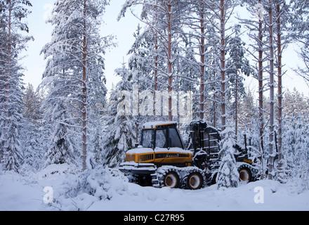 Ponsse Elk forest harvester in forest at Winter , Finland - Stock Photo