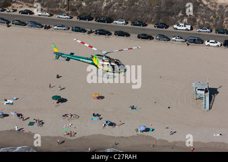 LOS ANGELES SHERIFF DEPARTMENT'S HELICOPTER (aerial view). Helicopter (as350 Eurocopter) patrolling the Malibu beach, - Stock Photo