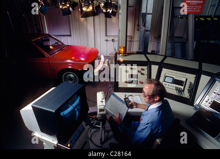 Male engineer performing an automobile bumper test in the laboratory of a chemical company - Stock Photo