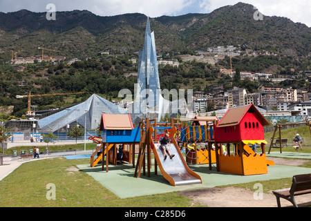 Childrens playground with safety rubber base in front of the Caldea building Escaldes-Engordany Andorra - Stock Photo