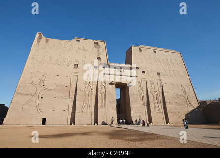 Edfu temple Luxor Egypt Africa showing the main entrance or pylon which is decorated in hieroglyphics - Stock Photo